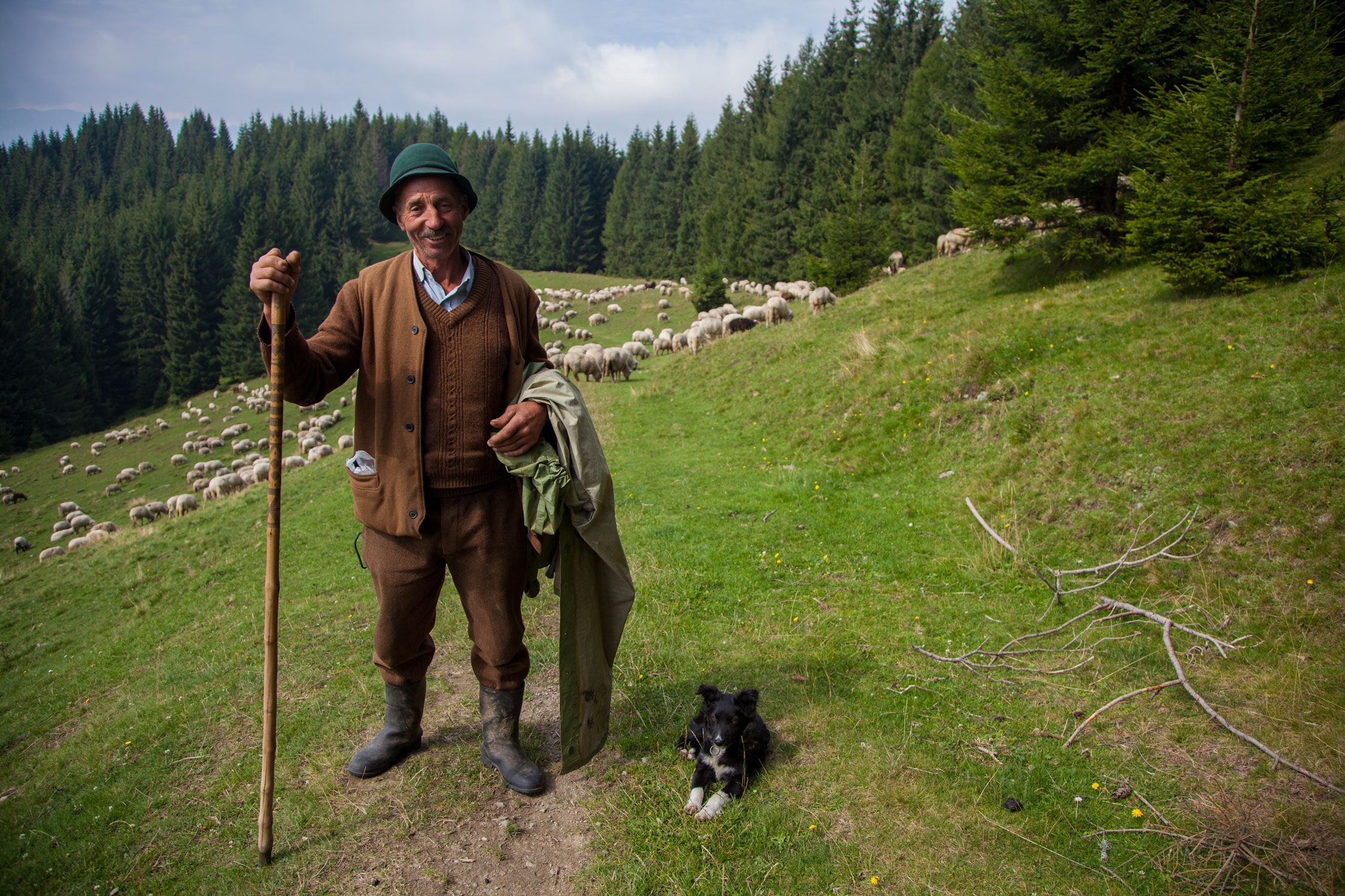 Romanian shepherd and his dog - photo by Cinty Ionescu and featured in this album on Flickr and shared under a CC BY 2.0 Creative Commons License